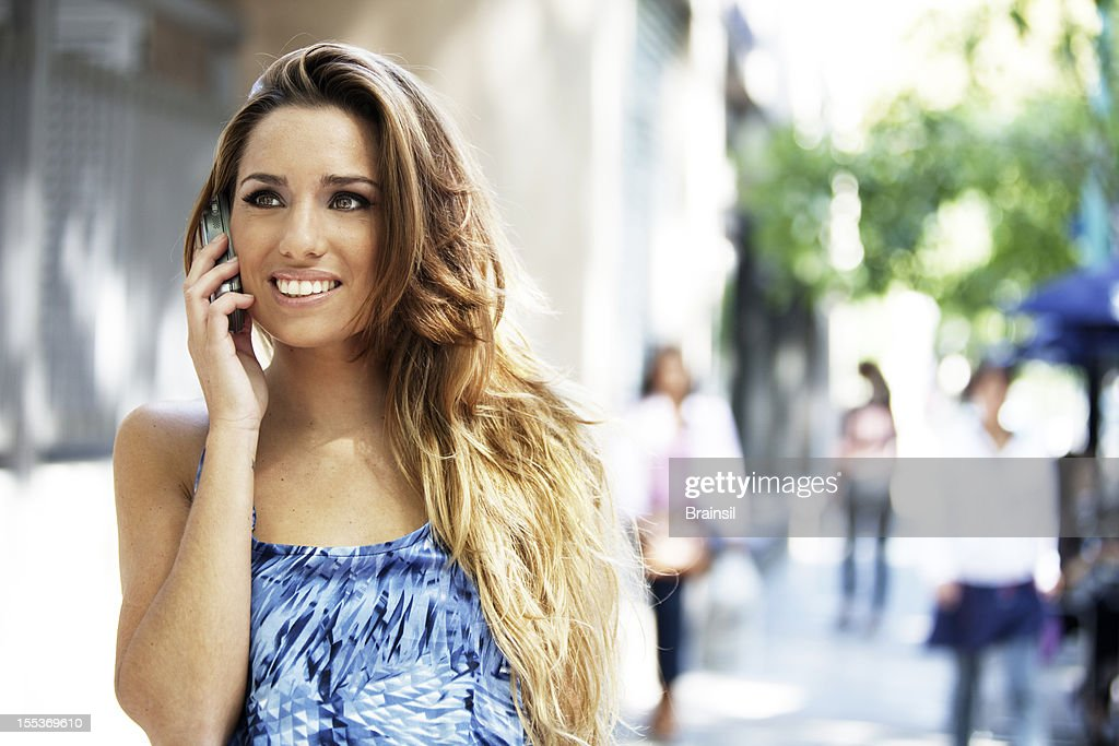 Happy Young Woman on the Phone : Stock Photo