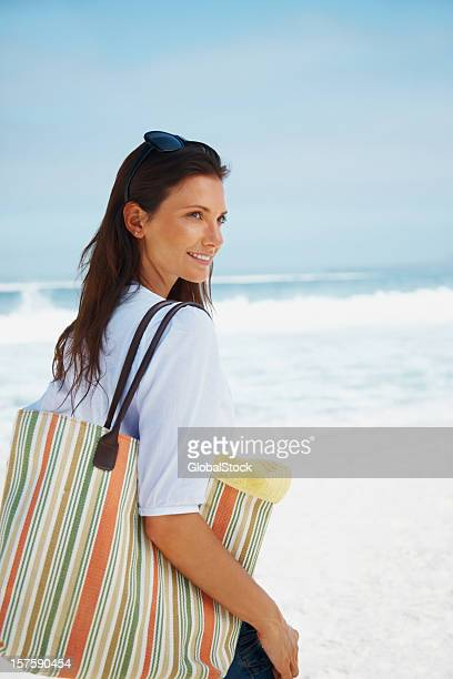 Happy young woman out on a beach picnic