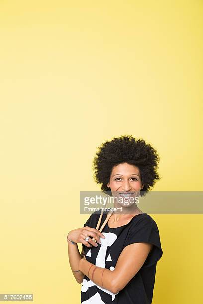 happy young woman playing african drum