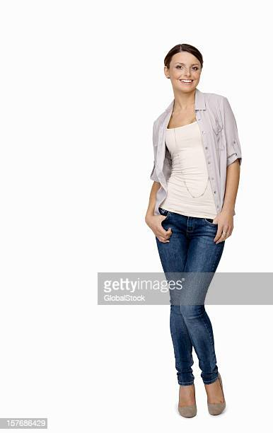 Happy young woman posing against white background - copyspace