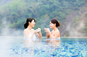 happy young woman relaxing in  hot springs