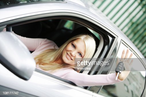 Happy Young Woman Sitting in New Car and Showing Keys : Stock Photo