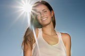 Happy young woman under blue sky, portrait