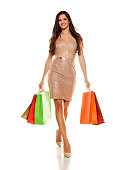 happy young woman walk and carry shopping bags