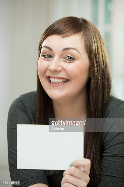 Happy young woman with a blank card