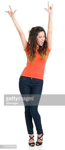 Happy Young Woman With Arms Up