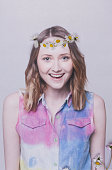 Happy young woman with flowers in hair