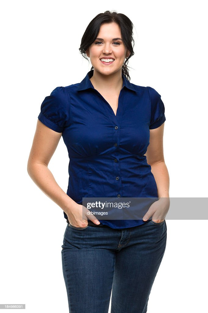 Happy Young Woman With Hands in Pockets