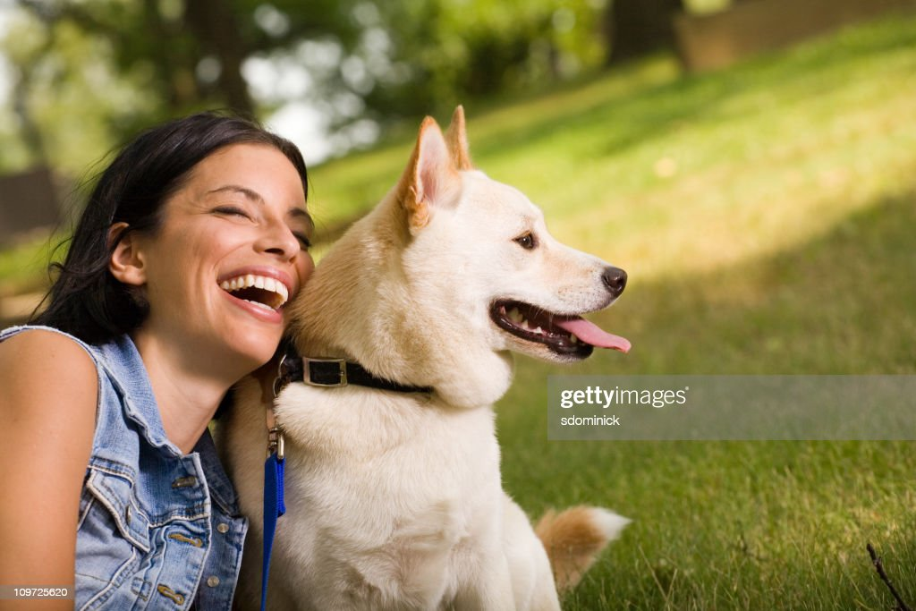 Happy Young Woman With Her Dog : Stock Photo