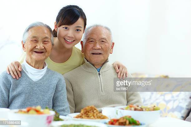 happy young woman with her grandparents indoor