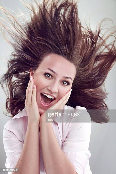 Happy young woman with long hair