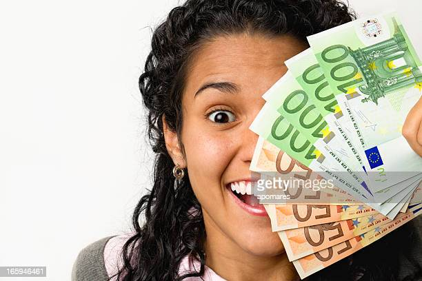 Happy young woman with money in hands
