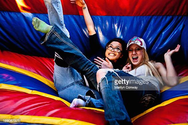 Happy young women on a bouncy slide