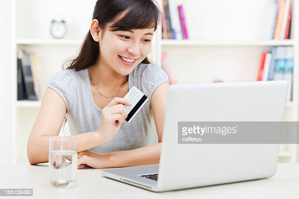 happy young women shopping online