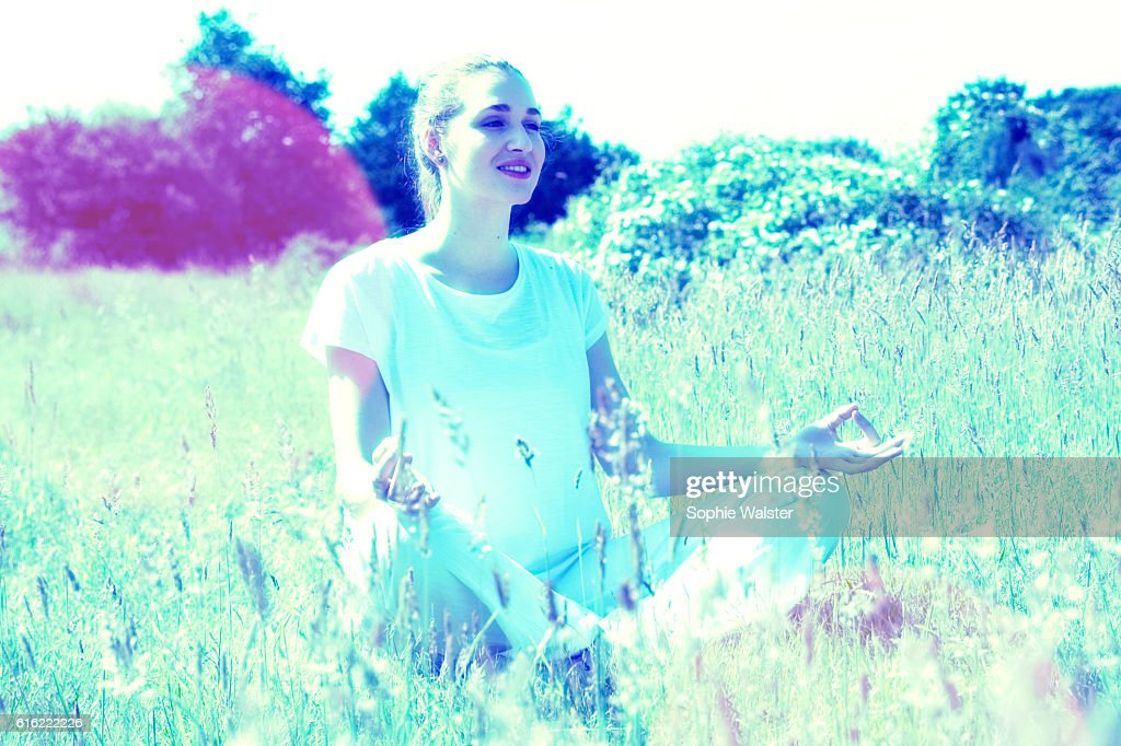 happy young yoga woman for energy and soul exercises outside : Stock Photo