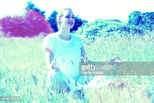 happy young yoga woman for energy and soul exercises outside : Stock-Foto