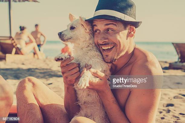 Happyman with a puppy in his arms