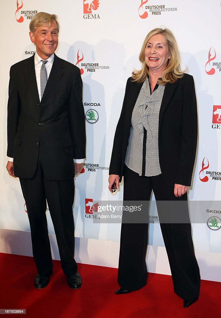 Harald Heker (L) and Marin Ruhfus arrive for the Deutscher Musikautorenpreis (German Songwriter Prize) 2013 ceremony at the Ritz Carlton hotel on April 25, 2013 in Berlin, Germany. The prize has been presented by GEMA (Gesellschaft fuer musikalische Auffuehrungs- und mechanische Vervielfaeltigungsrechte), the German society for musical performing and mechanical reproduction rights, since 2009.