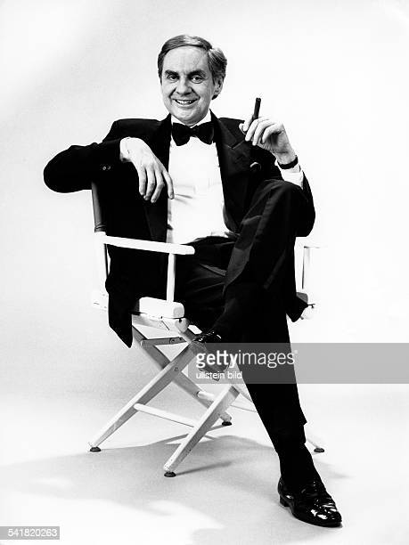 Harald Juhnke Harald Juhnke * Actor entertainer Germany Juhnke with a cigar sitting on a film producer's chair 1992