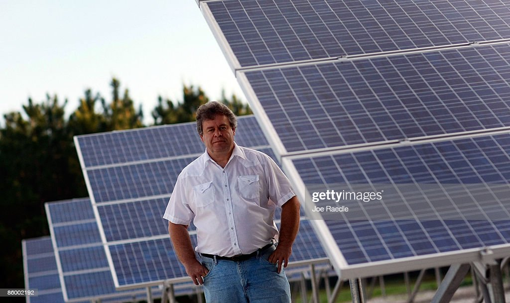 Harald Kegelmann from Advanced Solar Technologies company stands with a solar panel system his team put up at the Leveda Brown Environmental Park and Transfer Station on April 16, 2009 in Gainesville, Florida. Recently the city of Gainesville through a program initiated by the local Gainesville Regional Utilities became the first city in the nation to have a solar feed-in tariff ordinance which means owners of new solar photovoltaic systems will be eligible to receive 32 cents per kilowatt hour of electricity produced by the system over the next 20 years. The new program has produced a spurt of solar installation projects around the city. Other states and cities around the nation are eyeing the feed-in tariff program as a renewable energy program they might be interested in doing.