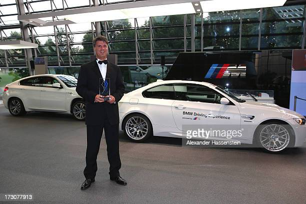 Harald Krueger Board of Management member for Production of BMW AG poses with the Bavarian Sportaward 2013 after the Bavarian Sport Award gala at BMW...