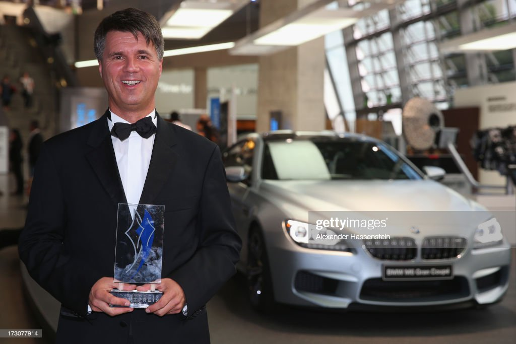 Harald Krueger, Board of Management member for Production of BMW AG poses with the Bavarian Sportaward 2013 after the Bavarian Sport Award gala at BMW Welt on July 6, 2013 in Munich, Germany.