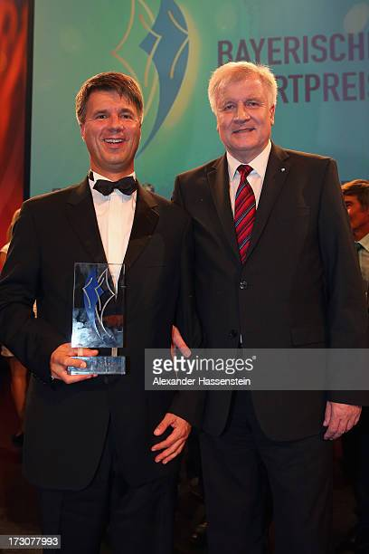 Harald Krueger Board of Management member for Production of BMW AG poses with Bavarian state governor Horst Seehofer after receiving the Bavarian...