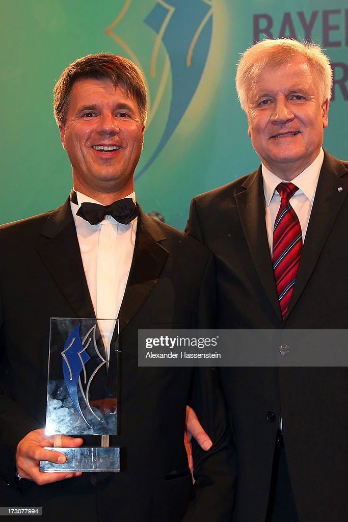 Harald Krueger, Board of Management member for Production of BMW AG poses with Bavarian state governor <a gi-track='captionPersonalityLinkClicked' href=/galleries/search?phrase=Horst+Seehofer&family=editorial&specificpeople=4273631 ng-click='$event.stopPropagation()'>Horst Seehofer</a> (R), after receiving the Bavarian Sportaward 2013 at the Bavarian Sport Award gala at BMW Welt on July 6, 2013 in Munich, Germany.