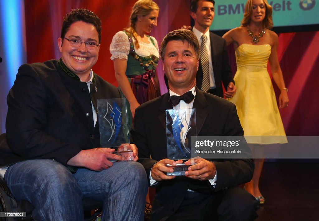 Harald Krueger, Board of Management member for Production of BMW AG poses with Birgit Kober, after receiving the Bavarian Sportaward 2013 at the Bavarian Sport Award gala at BMW Welt on July 6, 2013 in Munich, Germany.