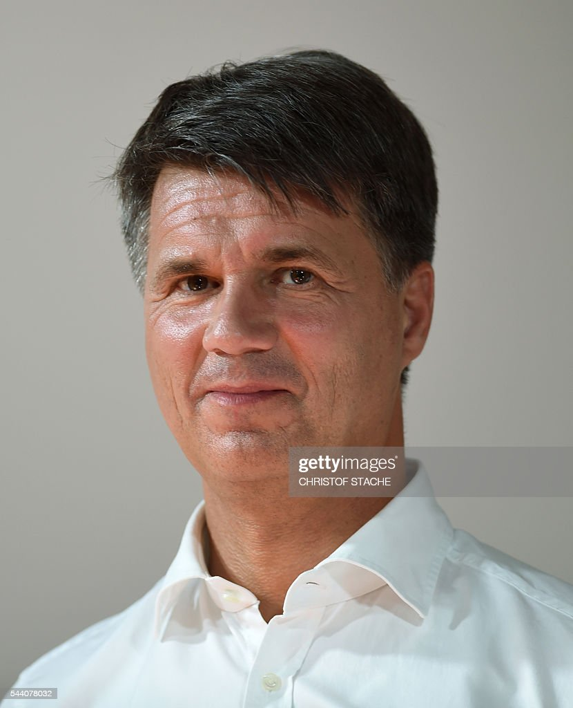 Harald Krueger, CEO of German car maker BMW, is pictured after a press conference in Munich, southern Germany, on July 1, 2016. The BMW Group, Intel and Mobileye, the three leaders from automotive, technology and computer vision and machine learning industries are collaborating to bring solutions for highly and fully automated driving into series production by 2021. / AFP / CHRISTOF