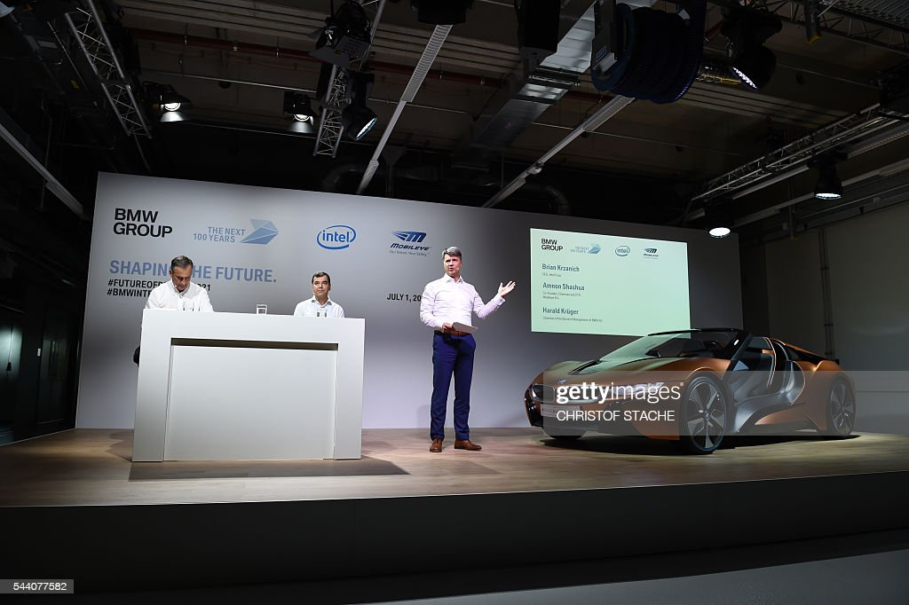 Harald Krueger, CEO of German car maker BMW, speaks beside Amnon Shashua, co-founder, chairman and CTO of Mobileye NV and Brian Krzanich, CEO of Intel during a press conference in Munich, southern Germany, on July 1, 2016. The BMW Group, Intel and Mobileye, the three leaders from automotive, technology and computer vision and machine learning industries are collaborating to bring solutions for highly and fully automated driving into series production by 2021. / AFP / CHRISTOF