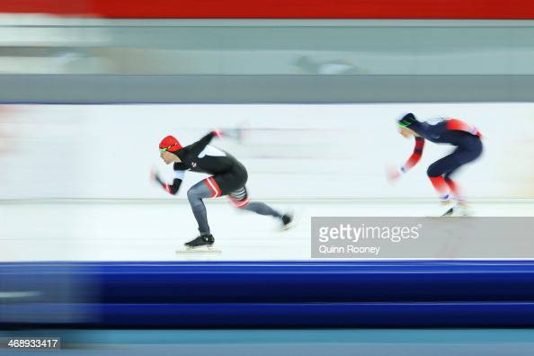 Haralds Silovs of Latvia and Benjamin Mace of France competes during the Men's 1000m Speed Skating event during day 5 of the Sochi 2014 Winter...