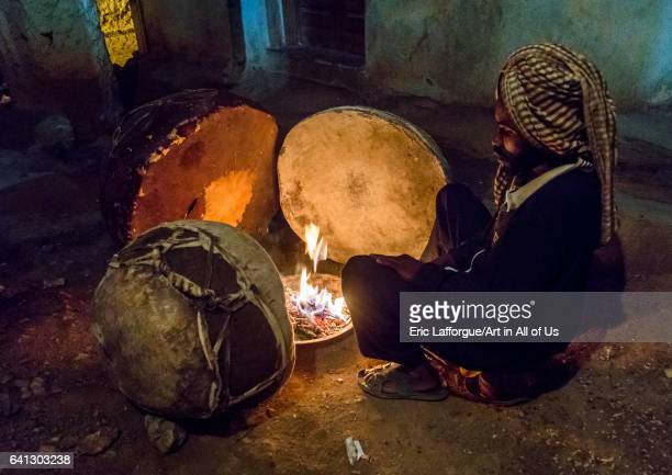 Harari man heating the drums before a ceremony in sufi community on January 13 2017 in Harar Ethiopia