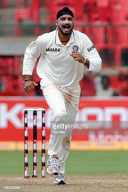 Harbhajan Singh celebrates capturing the wicket of Simon Katich during day four of the Second Test match between India and Australia at MChinnaswamy...