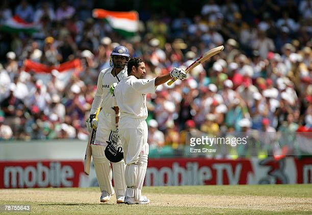 Harbhajan Singh congratulates Sachin Tendulkar of India as he celebrates his century during day three of the Second Test match between Australia and...