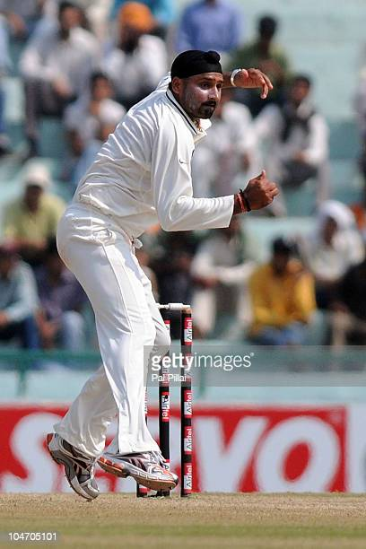 Harbhajan Singh of India bowls during day four of the First Test match between India and Australia at Punjab Cricket Association Stadium on October 5...