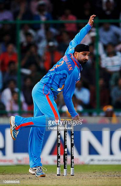 Harbhajan Singh of India bowls during the 2011 ICC Cricket World Cup Group B match between India and the Netherlands at Feroz Shah Kotla stadium on...