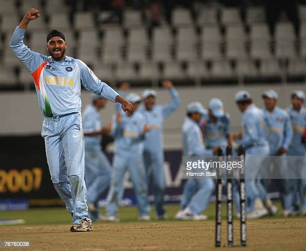 Harbhajan Singh of India celebrates after hitting the stumps in a bowl off eventually won by India after the match was tied at the end of both teams...