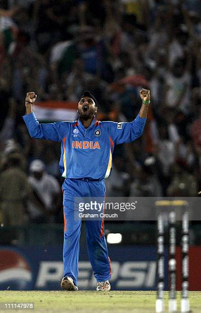 Harbhajan Singh of India celebrates after the dismissal of Shahid Afridi of Pakistan during the 2011 ICC World Cup second SemiFinal between Pakistan...