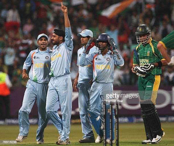 Harbhajan Singh of India celebrates his side's win with team mates during the ICC Twenty20 Cricket World Championship Super Eights match between...