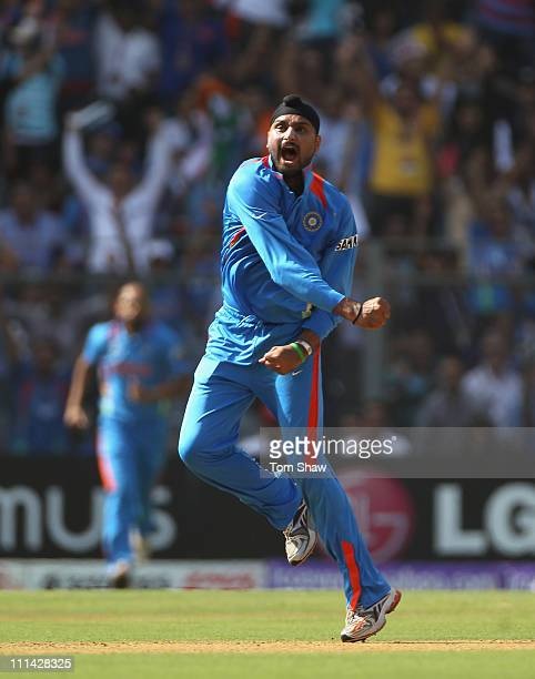 Harbhajan Singh of India celebrates taking the wicket of Tillakaratne Dilshan of Sri Lanka during the 2011 ICC World Cup Final between India and Sri...
