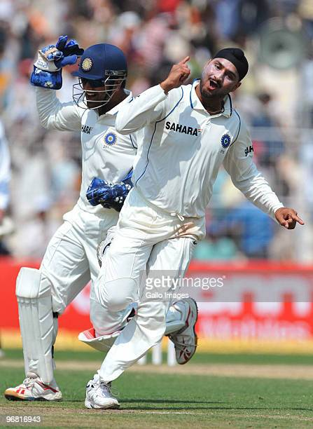 Harbhajan Singh of India celebrates the wicket of JP Duminy of South Africa for 6 runs during day five of the Second Test match between India and...