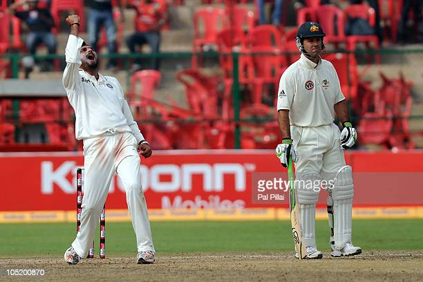 Harbhajan Singh of India celebrates the wicket of Marcus North during day four of the Second Test match between India and Australia at MChinnaswamy...