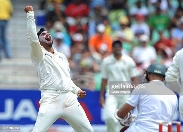 Harbhajan Singh of India traps Hashim Amla of South Africa lbw for 33 runs during day 2 of the 2nd Test match between South Africa and India at...
