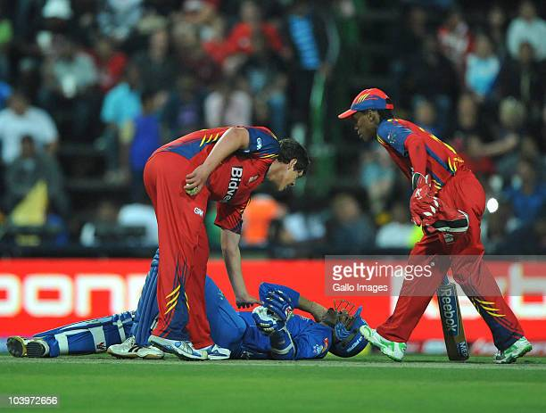 Harbhajan Singh of Mumbai Indians lies injured on the pitch during the Airtel Champions League Twenty20 match between Mumbai Indians and Highveld...