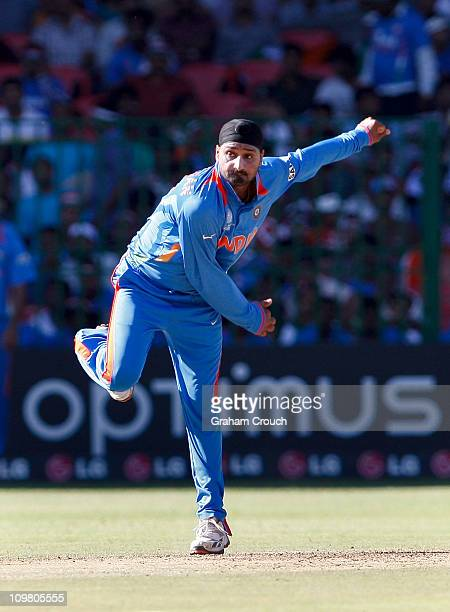 Harbharjan Singh of India bowls during the Group B 2011 ICC World Cup match between India and Ireland at M Chinnaswamy Stadium on March 6 2011 in...