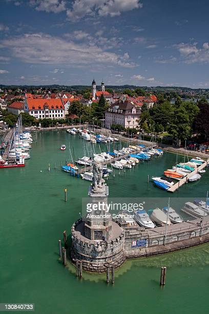 Harbor entrance with the Bavarian lion seen from the lighthouse, harbor and the downtown Lindau, Lake Constance, Bavaria, Germany, Europe