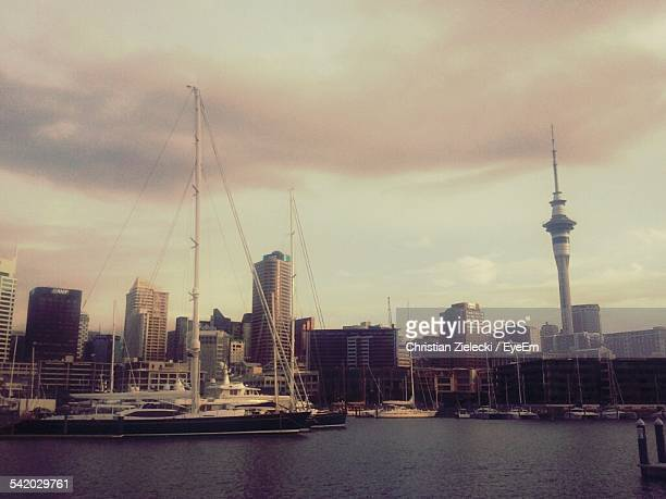 Harbor In Front Of Sky Tower And Modern Buildings In City