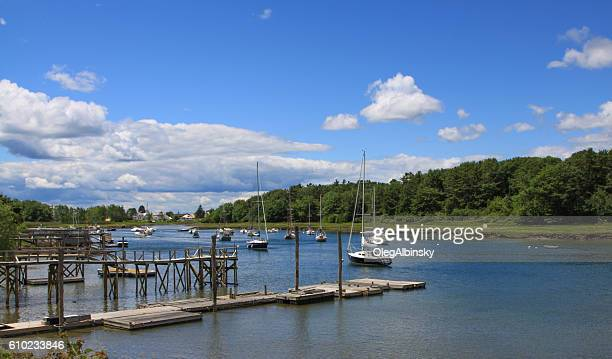 Harbor View, Pier and Moored Sailboats in Kennebunkport, Maine, USA.