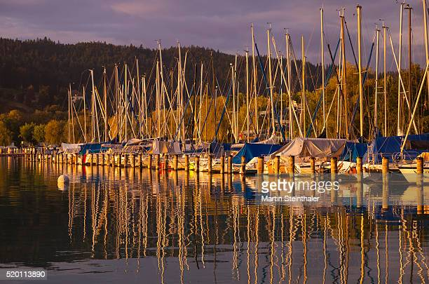 Harbour with small sailboats during sunset